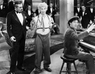 Louis Sorin with Chico and Harpo Marx, in Animal Crackers, 1930