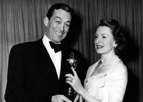Deborah Kerr presenting John Huston Oscar for Best Screenplay