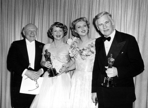 Walter Huston with Best Supporting Actress winner Clair Trevor (Key Largo) and the 1947 supporting winners Edmund Gwenn (Miracle on 34th Street) and Celeste Holm (Gentleman's Agreement)